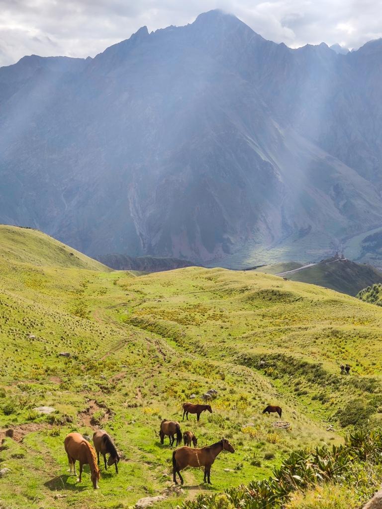 View of the Caucasus mountain range and Stepantsminda