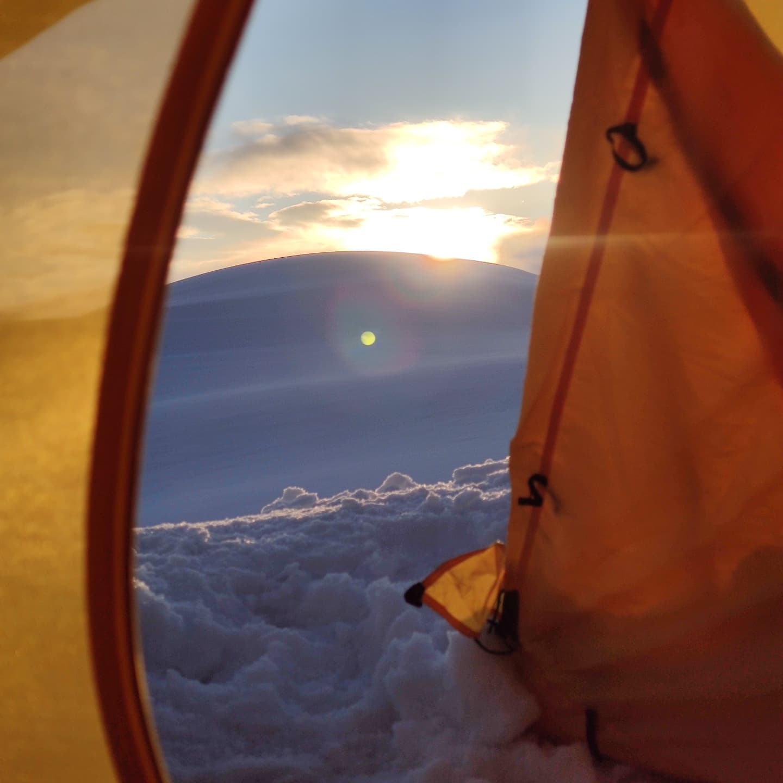 Kazbek tent glacier views sunset snow