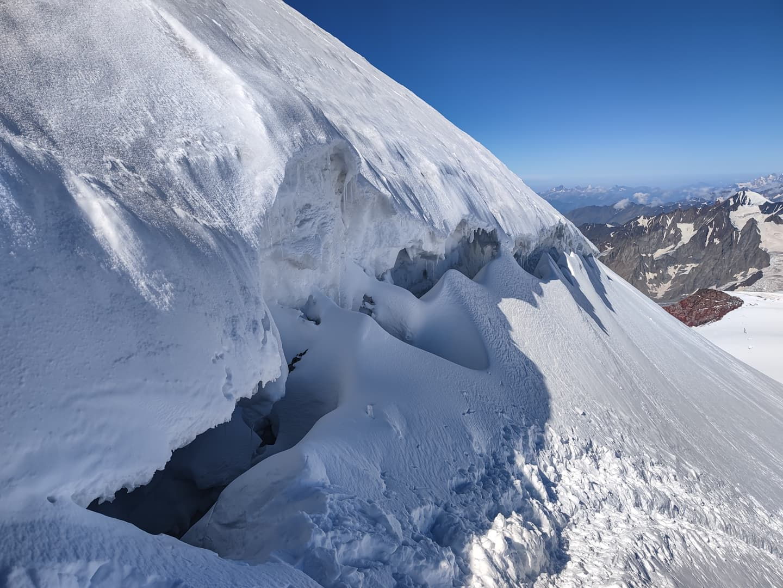 Kazbek glacier summit plateau 5054m Georgia Caucasus mountains serac crevasse