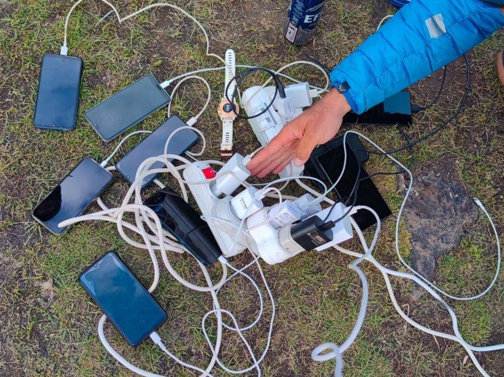 Ararat charging phones at base camp generator